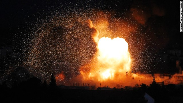 An explosion rocks Kobani during a reported car-bomb attack by ISIS militants on Monday, October 20.
