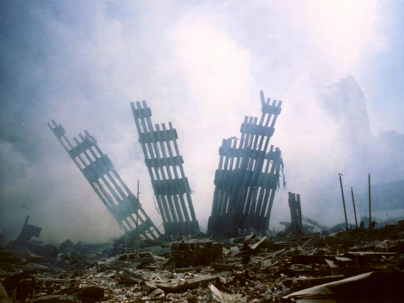 The remains of the World Trade Center stands amid the debris following the terrorist attack on the building in New York