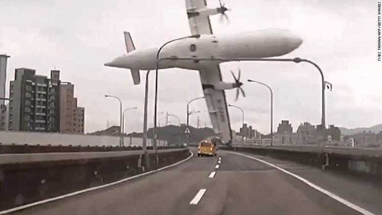 TransAsia Airways Flight GE235 clips a bridge in Taipei, Taiwan, shortly after takeoff Wednesday, February 4, in this still image taken from video. The ATR 72 twin-engine turboprop airplane then plunged into the Keelung River. More than 30 of the 58 passengers on board have been confirmed dead.