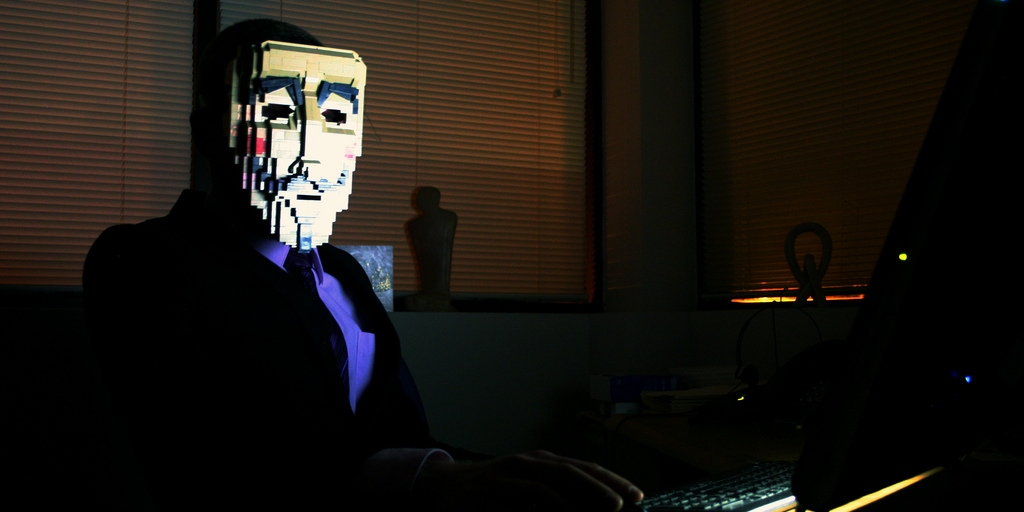 Anonymous Mask on Person Using Computer