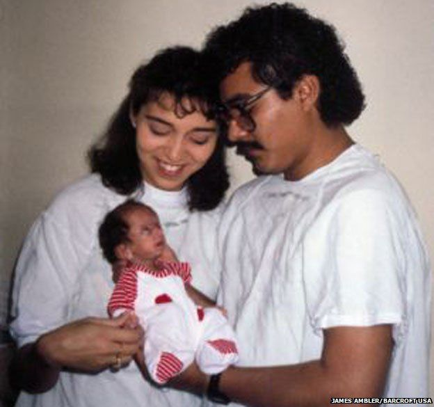 Lizzie as a baby with her parents