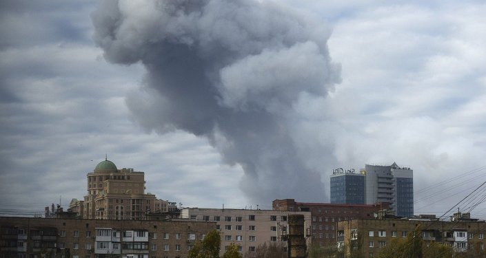 Smoke rises after shelling in the city of Donetsk, eastern Ukraine, Monday, Oct. 20, 2014
