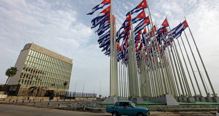 A car drives past the building of the the U.S. diplomatic mission in Cuba, The U.S. Interests Section, (USINT), in Havana, in this September 12, 2013 file picture.