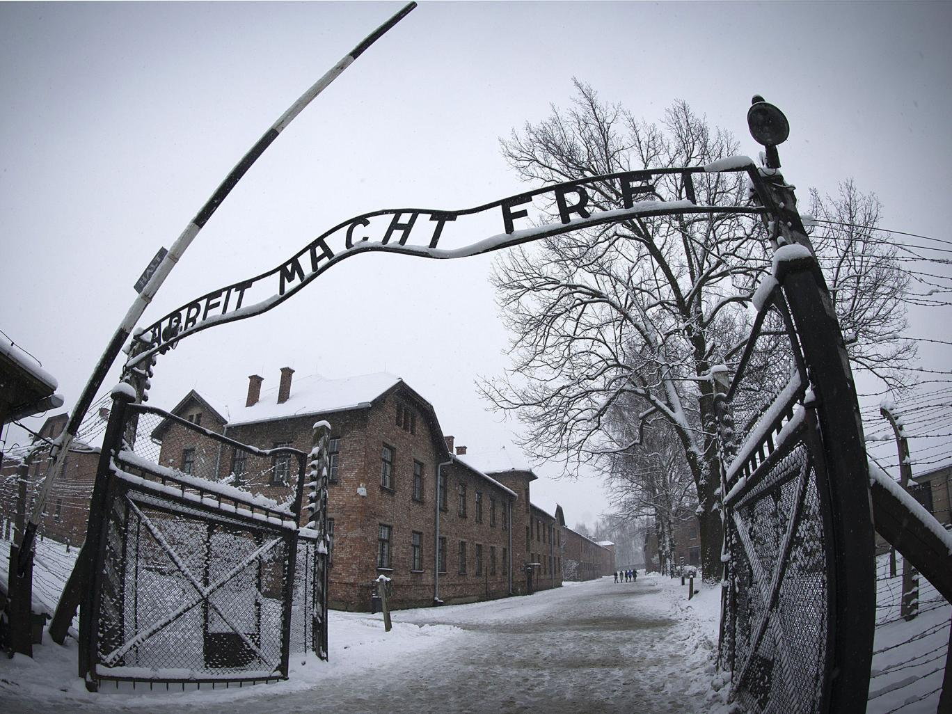 The entrance to the former Nazi concentration camp Auschwitz-Birkenau with the lettering &;Arbeit macht frei&; (&;Work makes you free&;)