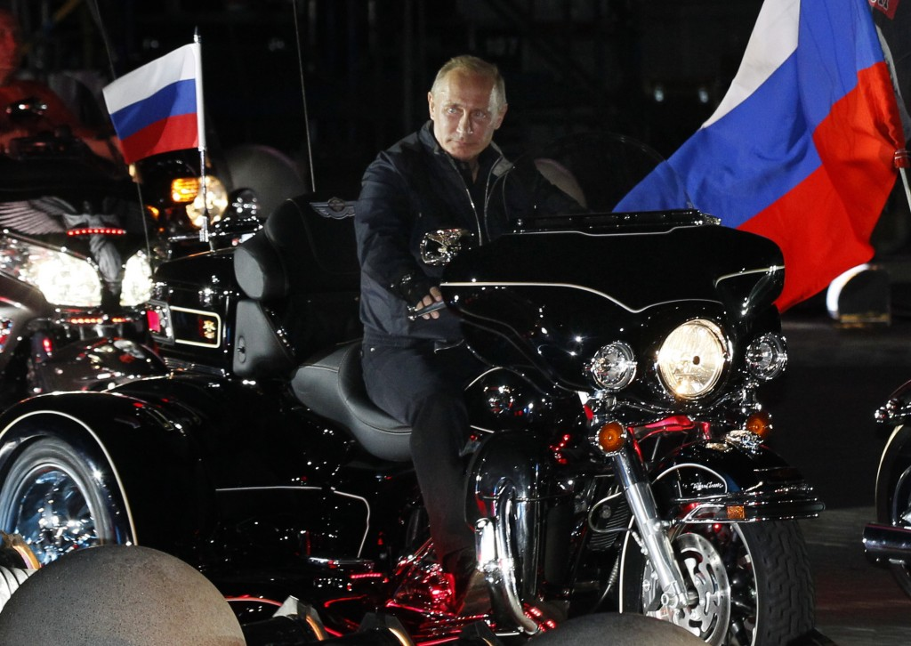 Vladimir Putin rides with enthusiasts during his visit to a bike festival in the southern Russian city of Novorossiisk