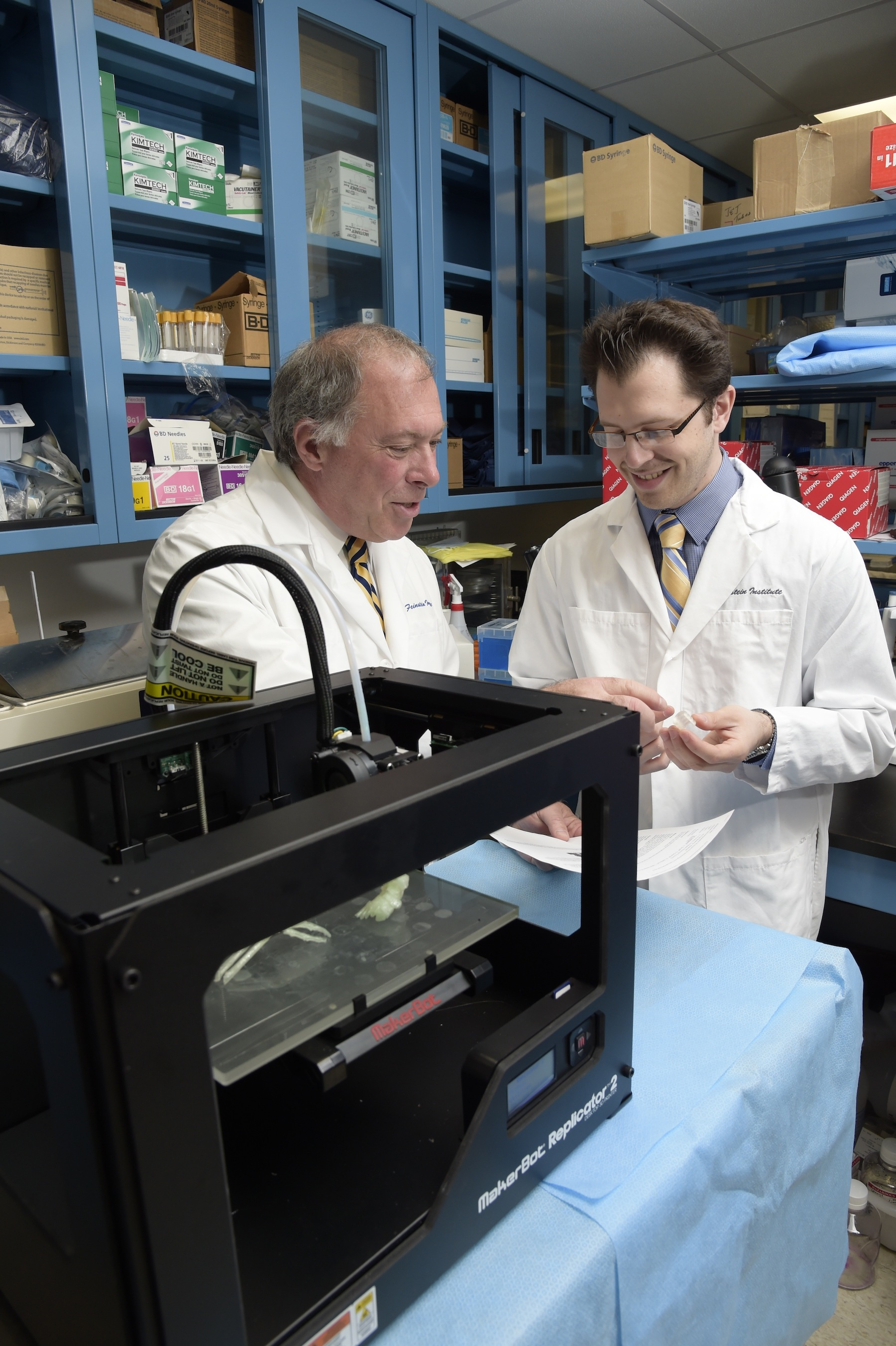 Daniel A. Grande, PhD, director of the Orthopedic Research Laboratory at the Feinstein Institute, and Todd Goldstein, an investigator at the Feinstein Institute, part of the North Shore-LIJ Health System, examine some of the 3D-printed parts they made on their MakerBot Replicator Desktop 3D Printer.