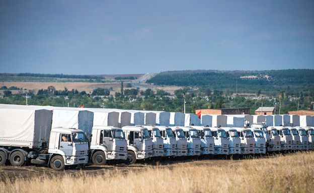Lorries part of a Russian humanitarian convoy are parked not far from a checkpoint at the Ukrainian border some 30 km outside the town of Kamensk-Shakhtinsky in the Rostov region, on August 20, 2014.