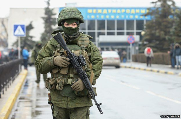 Soldiers, who were wearing no identifying insignia and declined to say whether they were Russian or Ukrainian, patrol outside the Simferopol International Airport, February 2014