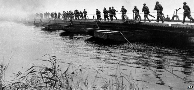 Soviet troops cross a pontoon bridge at the Western Bug in July 1944, as part of Operation Bagration