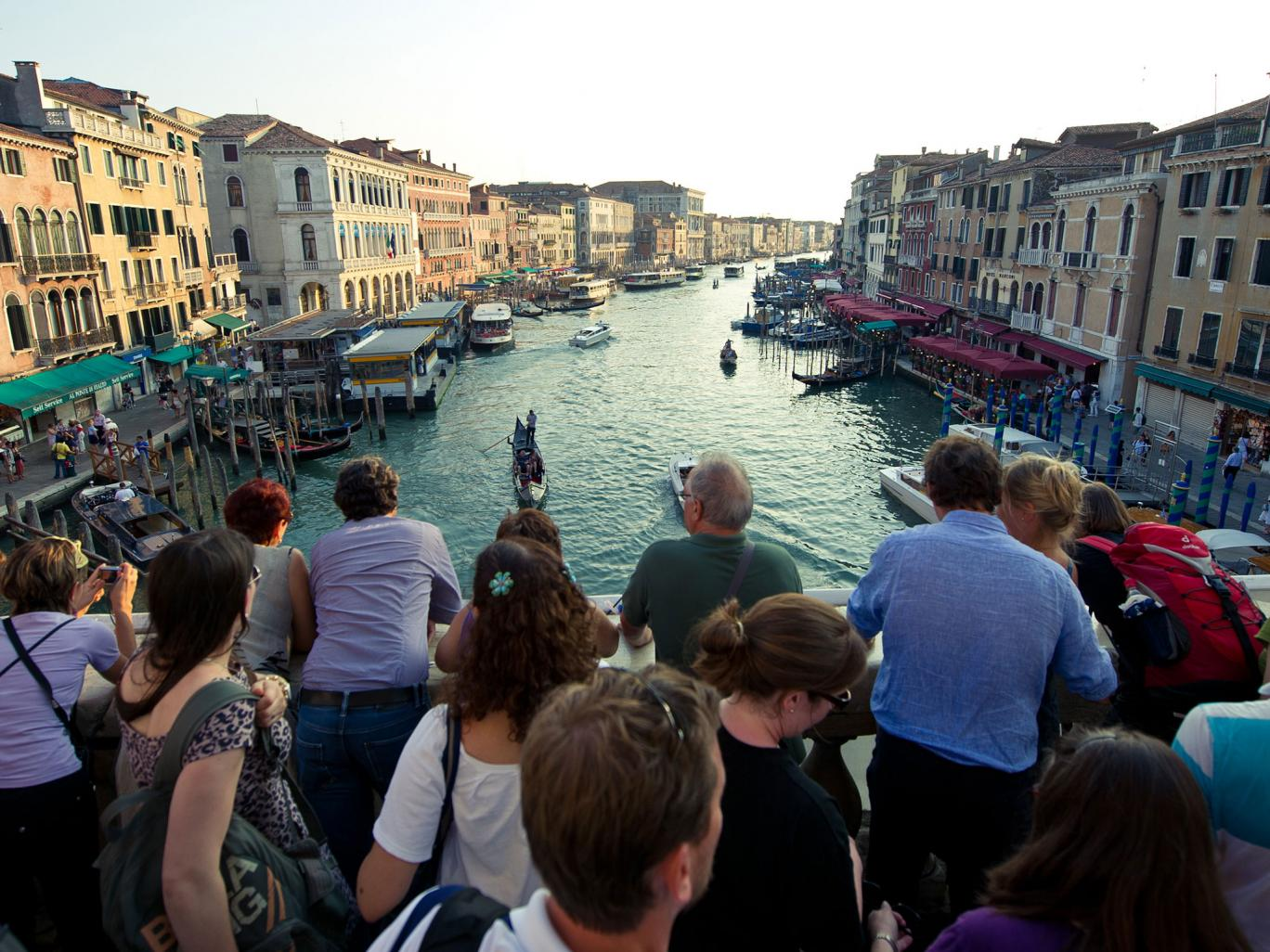 A bridge too far: increasing numbers of day-trippers are crowding Venice's attractions such as the Rialto Bridge